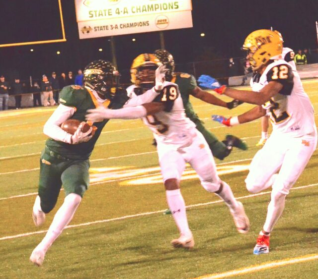 Reynolds receiver Jhari Patterson won the major sports male star award, from larger-population schools. Here in his final Rocket game, he fights off Belton Pressley (8) of Kings Mountain in round three of playoffs. Photo by Pete Zamplas.
