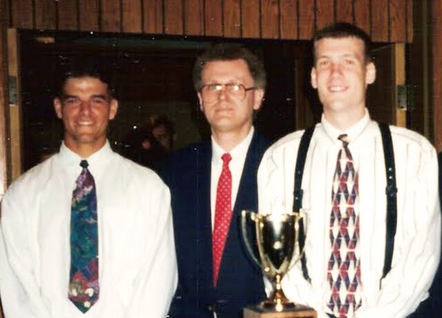 West Falcon basketball senior co-captains Luke Manuel, at left, and Joey Bryson flank head coach Rick Wood at the WNC Sports Award Banquet for 1994-95.