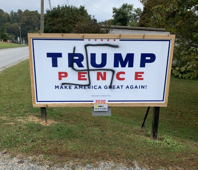 A swastika symbol was placed on this billboard near the Brevard High School. Photo courtesy of Transylvania County Republican Party.