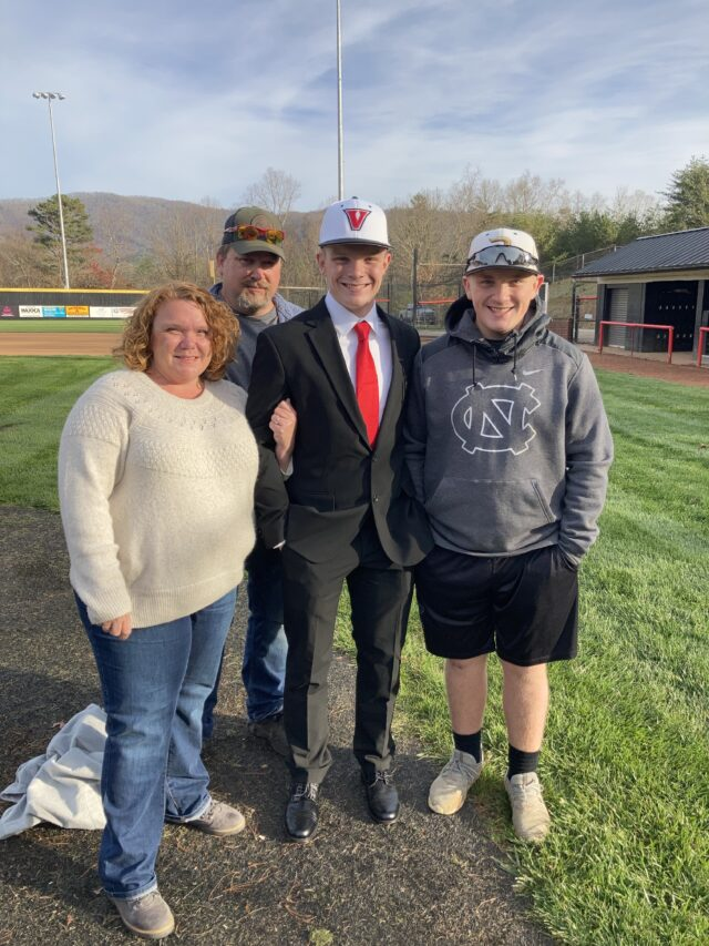 Cody Kirkpatrick and his family stand centerfield at North Buncombe High School. Photo by Anthony Abraira.