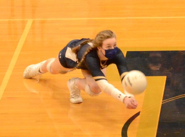 Mackenzie Lynch digs to keep the point going for Roberson. Photo by Pete Zamplas.