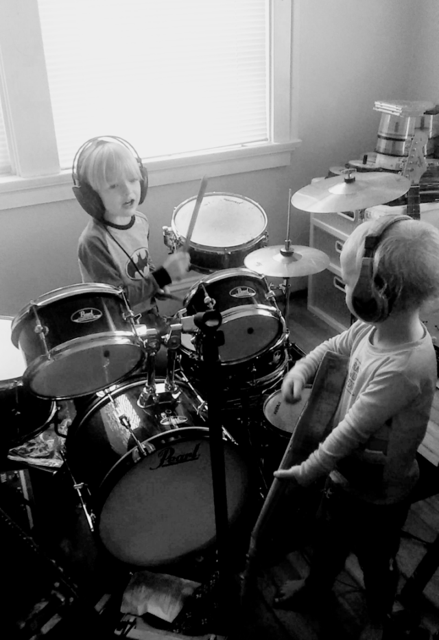 The two boys, Colin and Evan, play and sing just like their Dad.