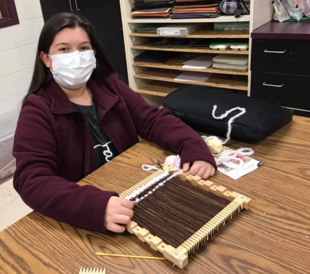 Jordan Treadway, 7th grader at Madison Middle School, shows off her hand-made loom and her textile design in process during Kerstin Davis' Visual Arts class. Photo submitted by Sarah Scully.